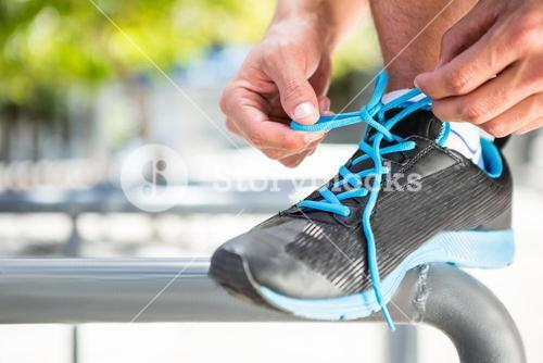 Athlete tying his shoes