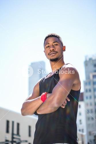 Portrait of an handsome athlete with arm crossed