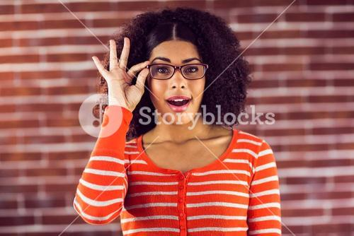 Attractive woman posing with hipster glasses