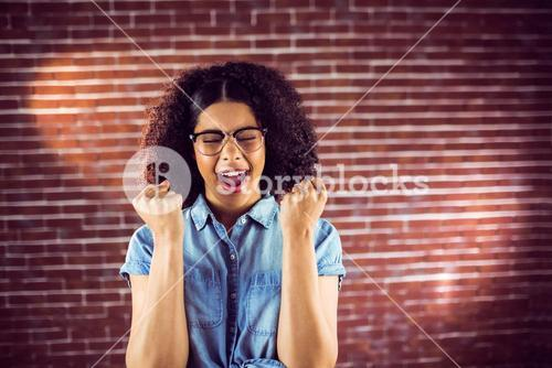 Attractive hipster celebrating success