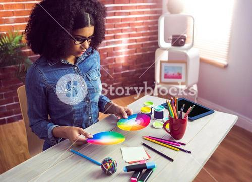 Casual businesswoman holding two color wheel