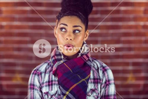 A beautiful happy hipster whistling