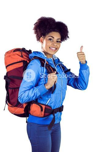 Young woman with backpack hitchhiking