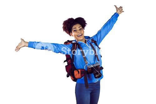 Ecstatic young woman with arms in the air