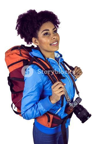 A young woman with camera and backpack