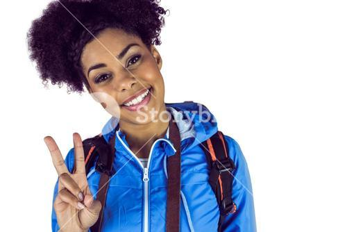 Young woman doing the peace sign