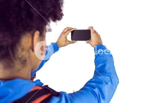 Young woman with backpack taking picture