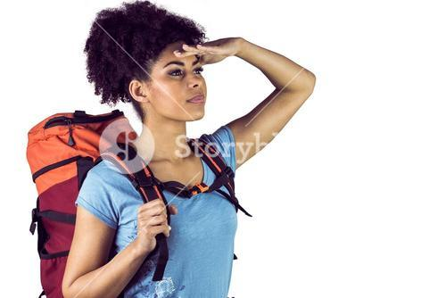 Young woman with backpack looking away
