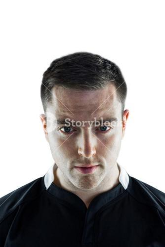 A rugby player looking down