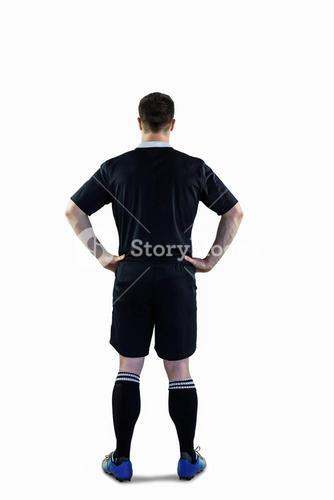 Rugby player with hands on hips