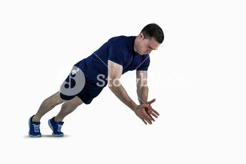 A fit man doing clapping hands push ups