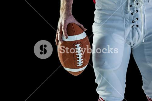 American football player holding football
