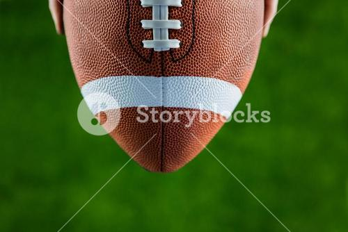 Close up view of upheld football