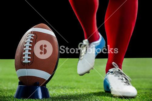 American football player being about to kick football