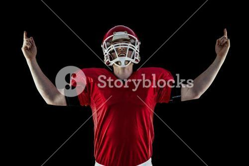 American football player triumphing