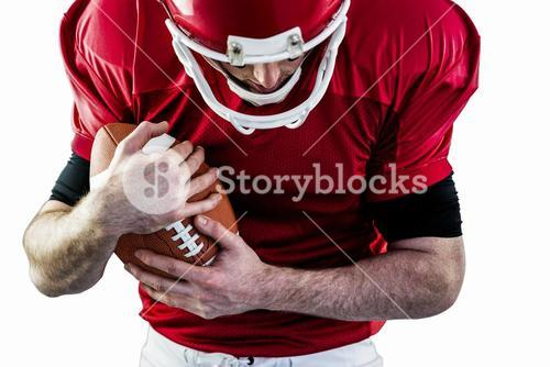 American football player protecting football