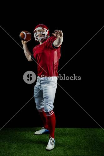 American football player throwing football