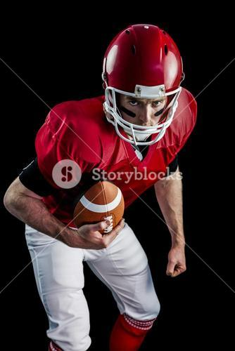 Portrait of focused american football player being ready to attack