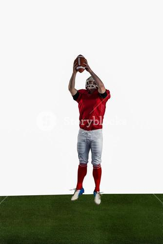 American football player catching football