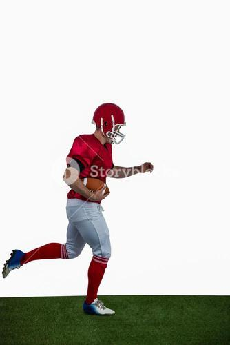 American football player running with football