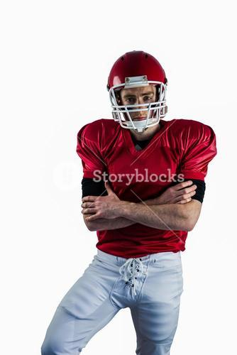 Portrait of serious american football player with arms crossed
