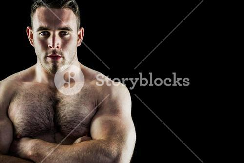 Handsome bodybuilder with arms crossed