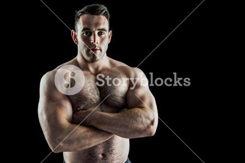 Strong bodybuilder with arms crossed