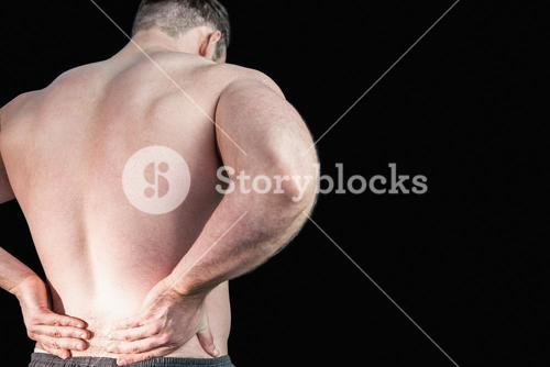 Strong bodybuilder with painful back