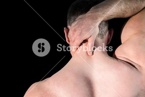 Strong bodybuilder with painful neck