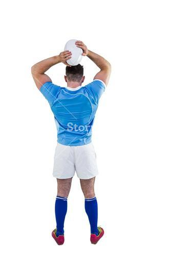 Rugby player throwing the ball