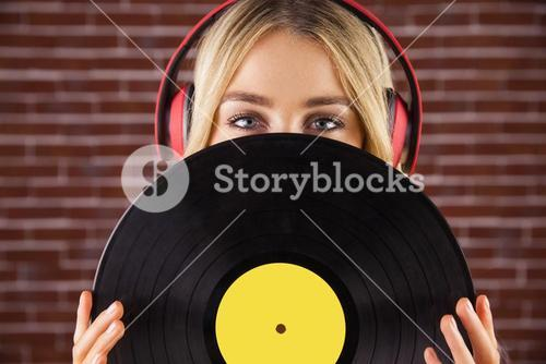 Portrait of a beautiful woman holding a vinyl