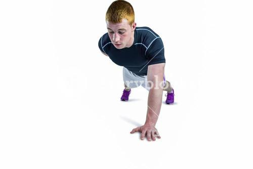 Muscular rugby player doing one hand push ups