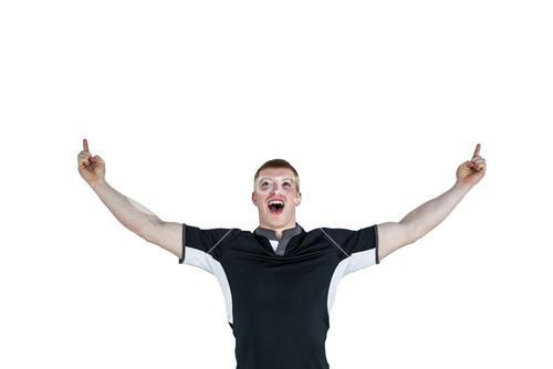 A rugby player gesturing victory