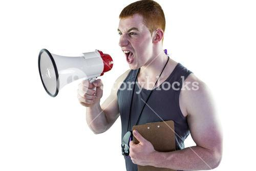 Angry personal trainer yelling through megaphone