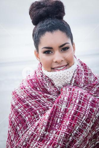 Beautiful woman wrapped up in warm clothing
