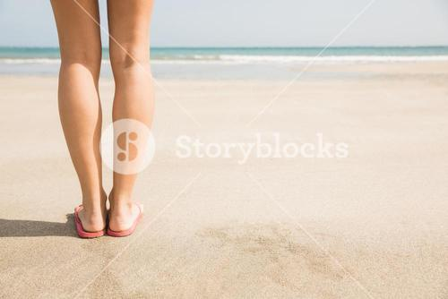 Woman standing on the sand