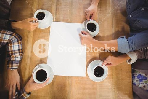 Friends sitting and drinking coffee