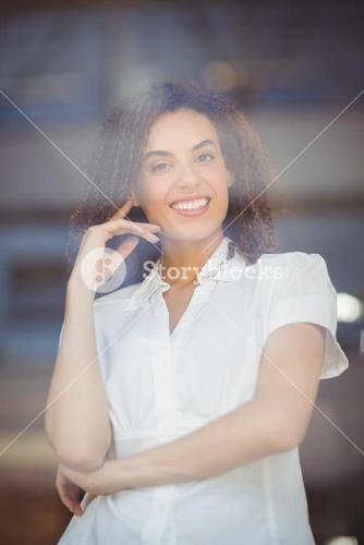 Smiling woman with arms folded