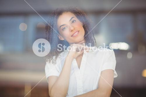 Carefree woman with arms folded