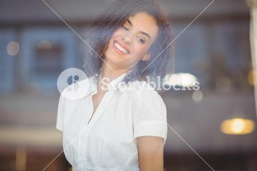 Carefree woman looking through the window