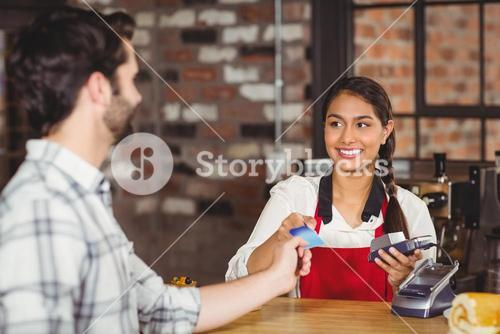 Customer handing a credit card to the waitress