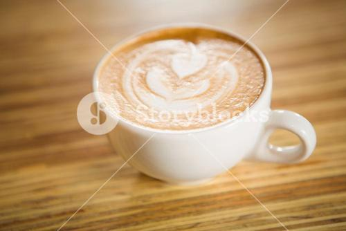 Close up view of cappuccino with coffee art
