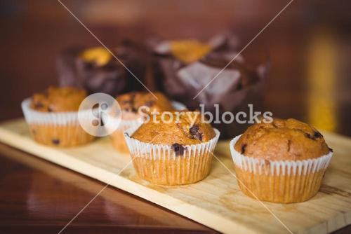Chocolate chip muffins on cutting board