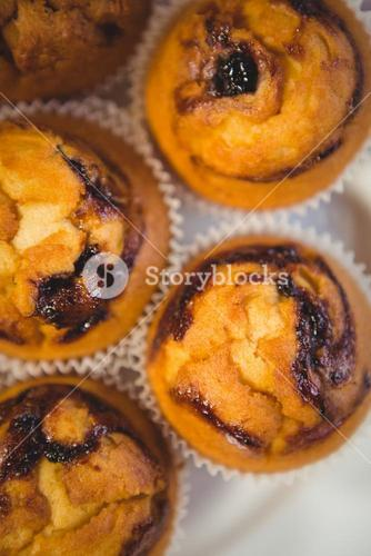 Close up view of blueberry muffins on a plate