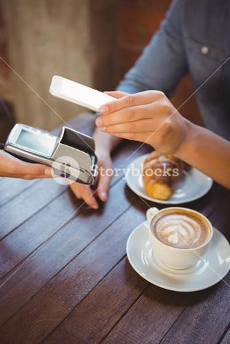 Male customer paying with smartphone