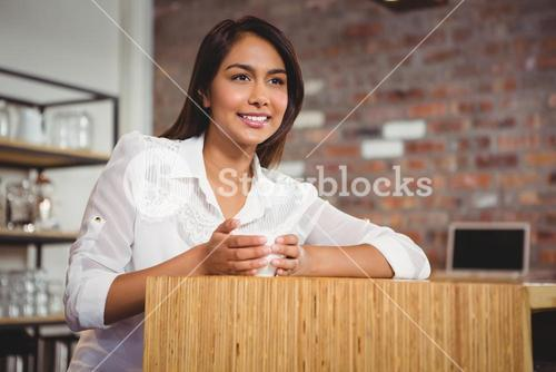 Pretty brunette having cup of coffee