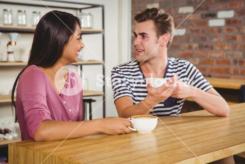 Cute couple drinking a coffee together