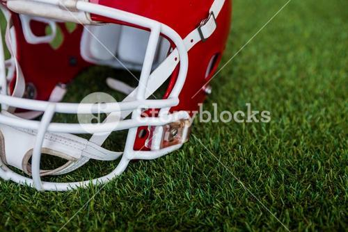 An american football helmet on the field