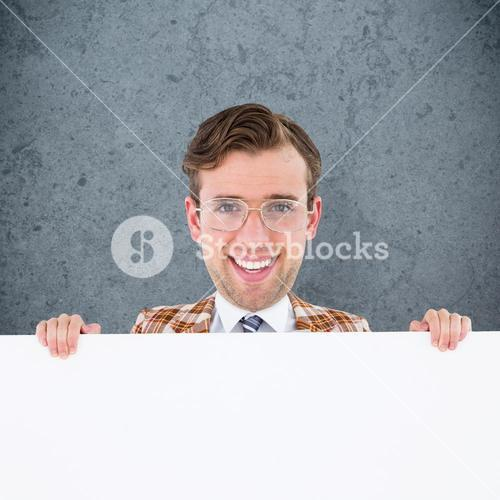 Composite image of geeky businessman showing card