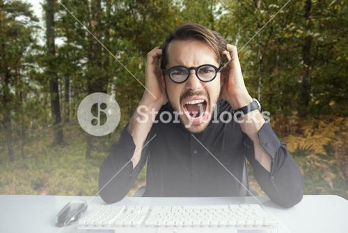 Composite image of businessman yelling with his hands on face